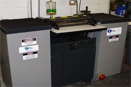 image of a slicing machine used to make thin slices of elastomer for cutting of test specimens