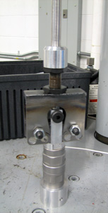 bend fixture on high strain test instrument with slack grip, bend test